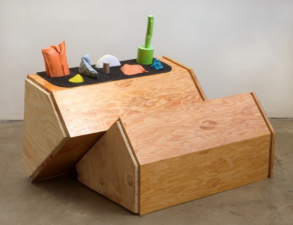 Erik Frydenborg, Untitled (Refrain), 2009. Pigmented polyurethane (plastic and foam), rubber welcome mat, replicated plywood pedestals.28 x 40 x 27 inches.