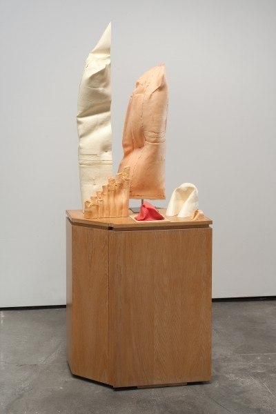 Erik Frydenborg, Sextet, 2008. Pigmented polyurethane, latex rubber, aluminum display stand, found wooden pedestals. 76 x 32 x 24 inches.