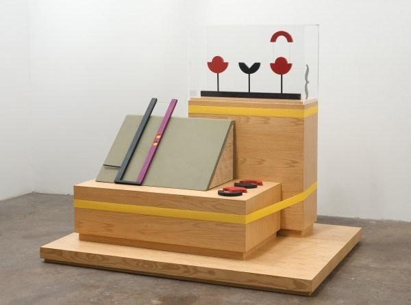 Erik Frydenborg, Service Manikin, 2012. Ash plywood pedestals and plinth, acrylic vitrine, maple, pine, twill, elastic. 56 x 68 x 48 inches.