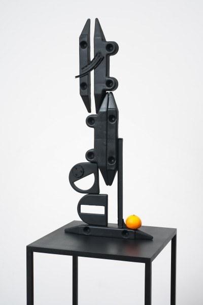 Erik Frydenborg, Structure with Memorized Orange, 2012. Patinated aluminum, synthetic fruit. 79 x 18 x 18 inches.