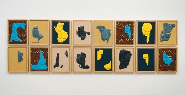 Erik Frydenborg, Sems, 2013. Pigmented polyurethane, linen, cotton polyester blend, Bogolan, pine artist's frames, 16 parts. Installation view.